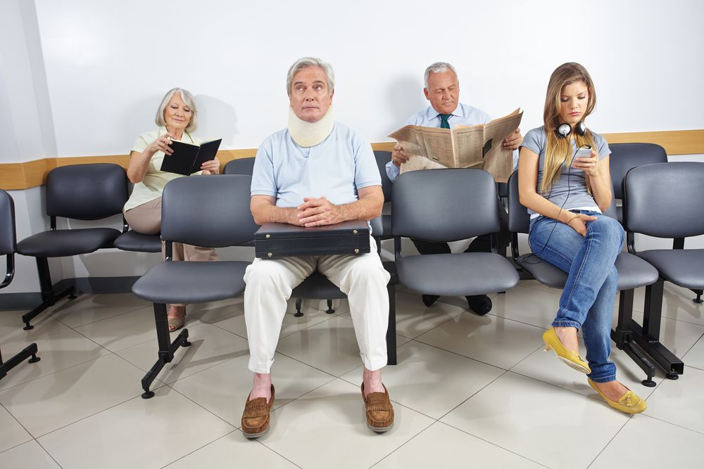 group of patients wait for medical care in urgent care clinic